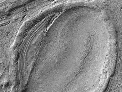 Ледяные глыбы заполняли глубочайшие места Марса?