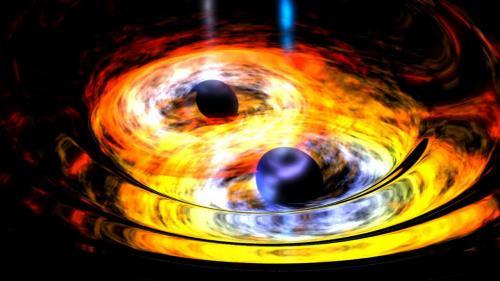 Две черные дыры сплелись в гравитационном танго.